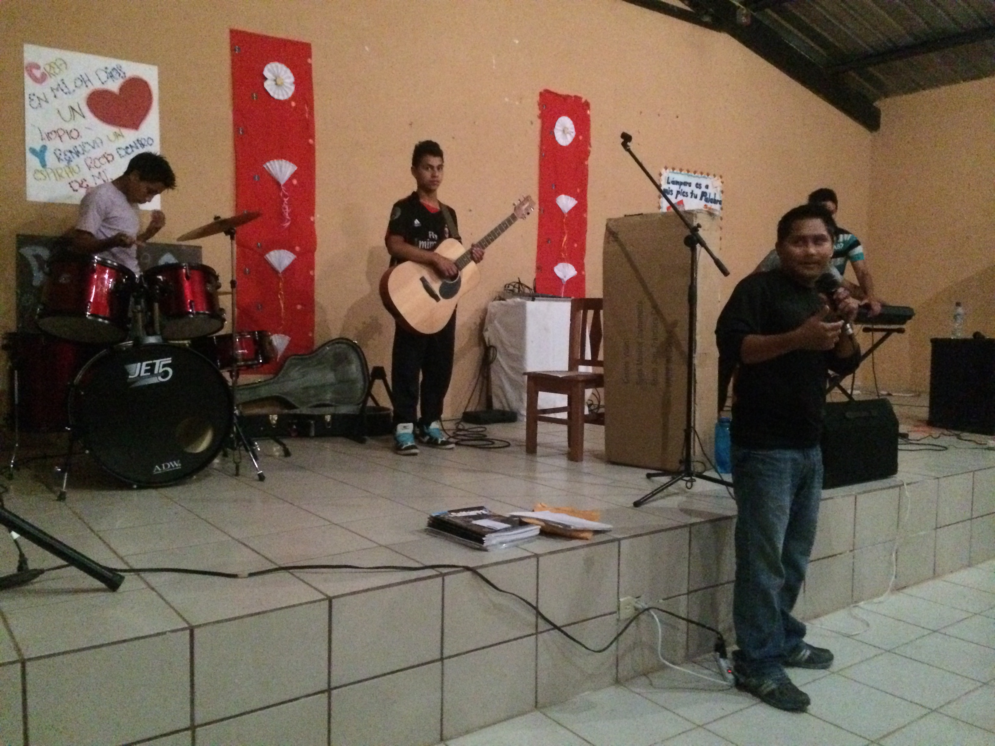 Buen Pastor boys leading worship