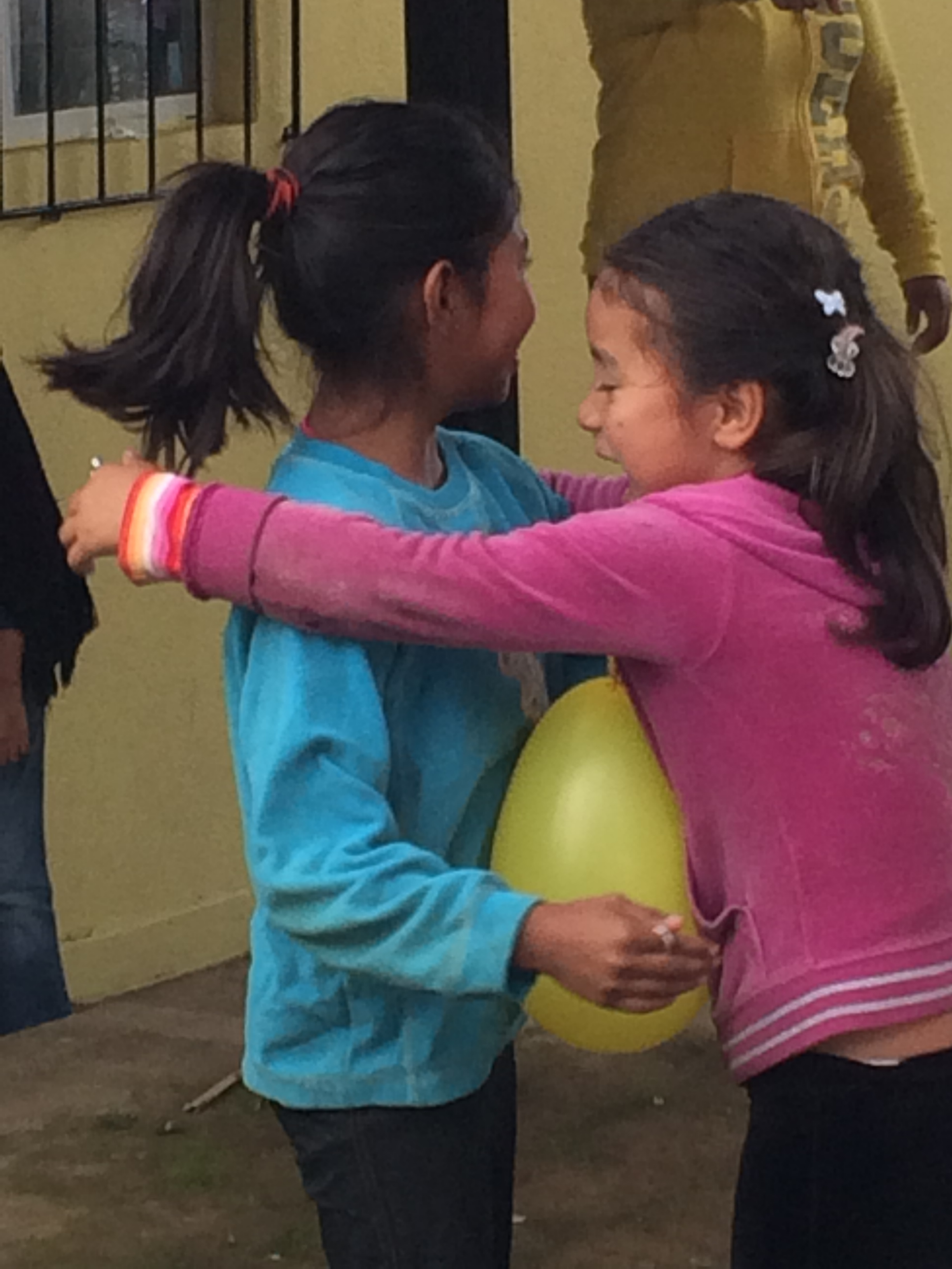 Trying to break a balloon between them