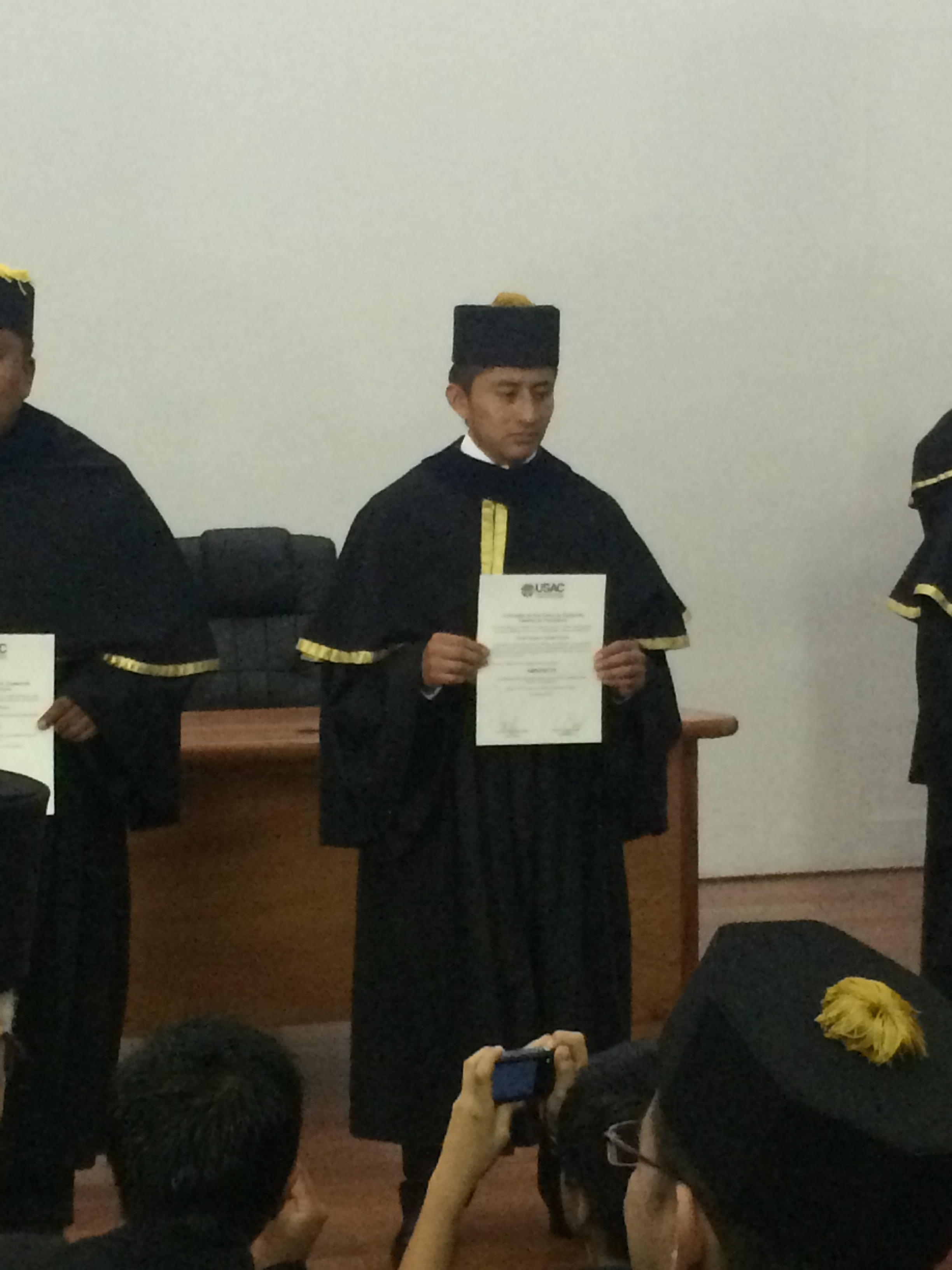 Oscar with his diploma