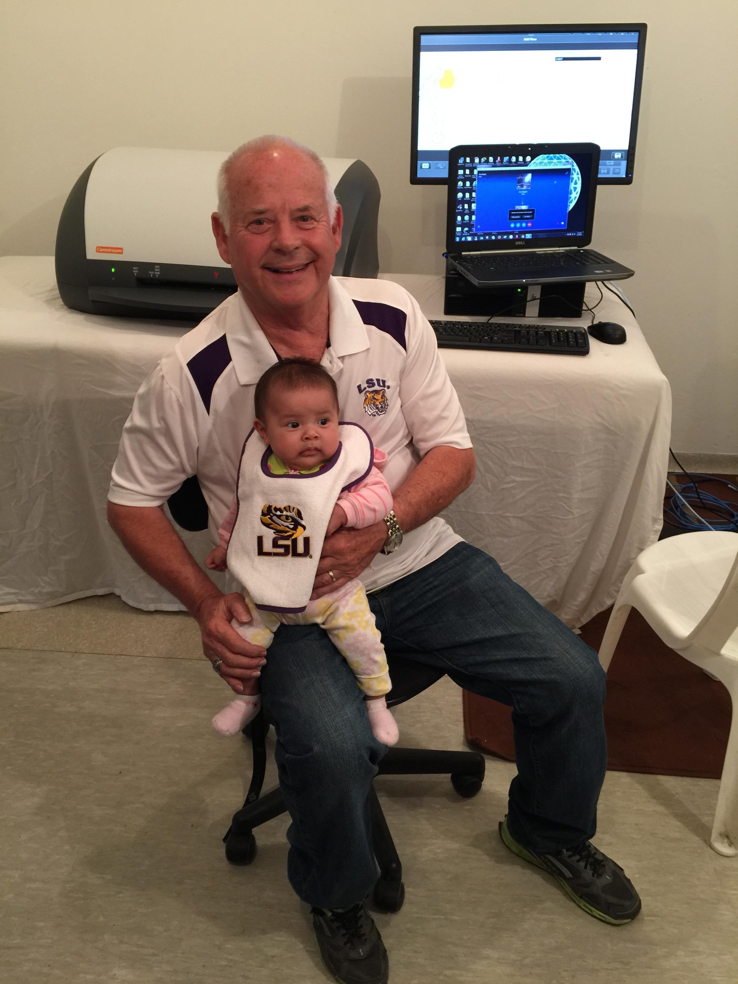 The youngest LSU fan sitting in front of the new digital x-ray setup.
