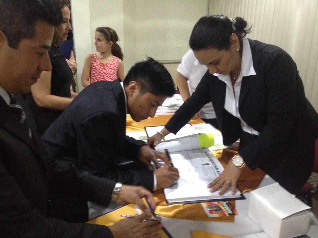 Signing the legal documentation as a now certified architect.