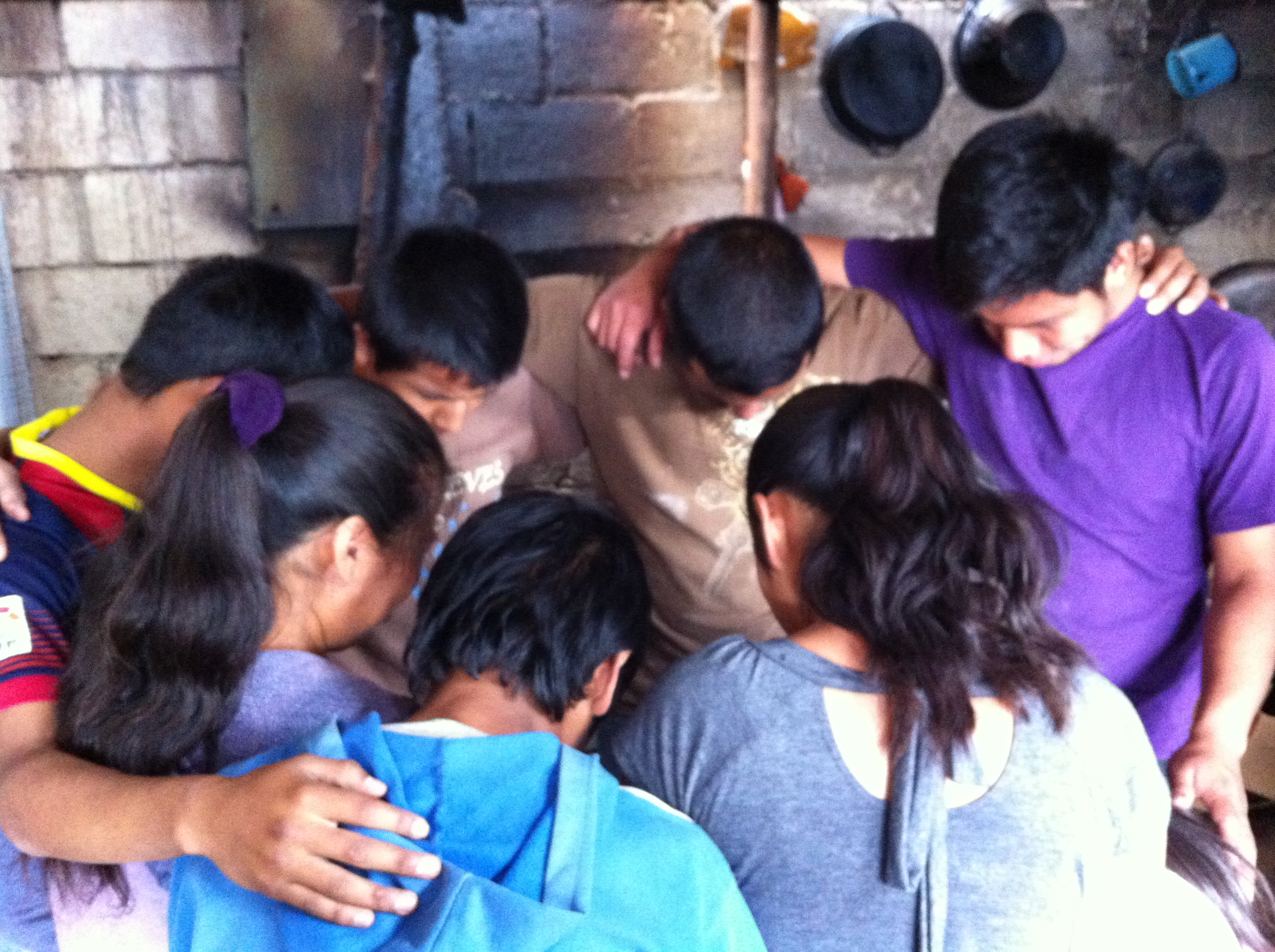 boys prayin after 1st instalation