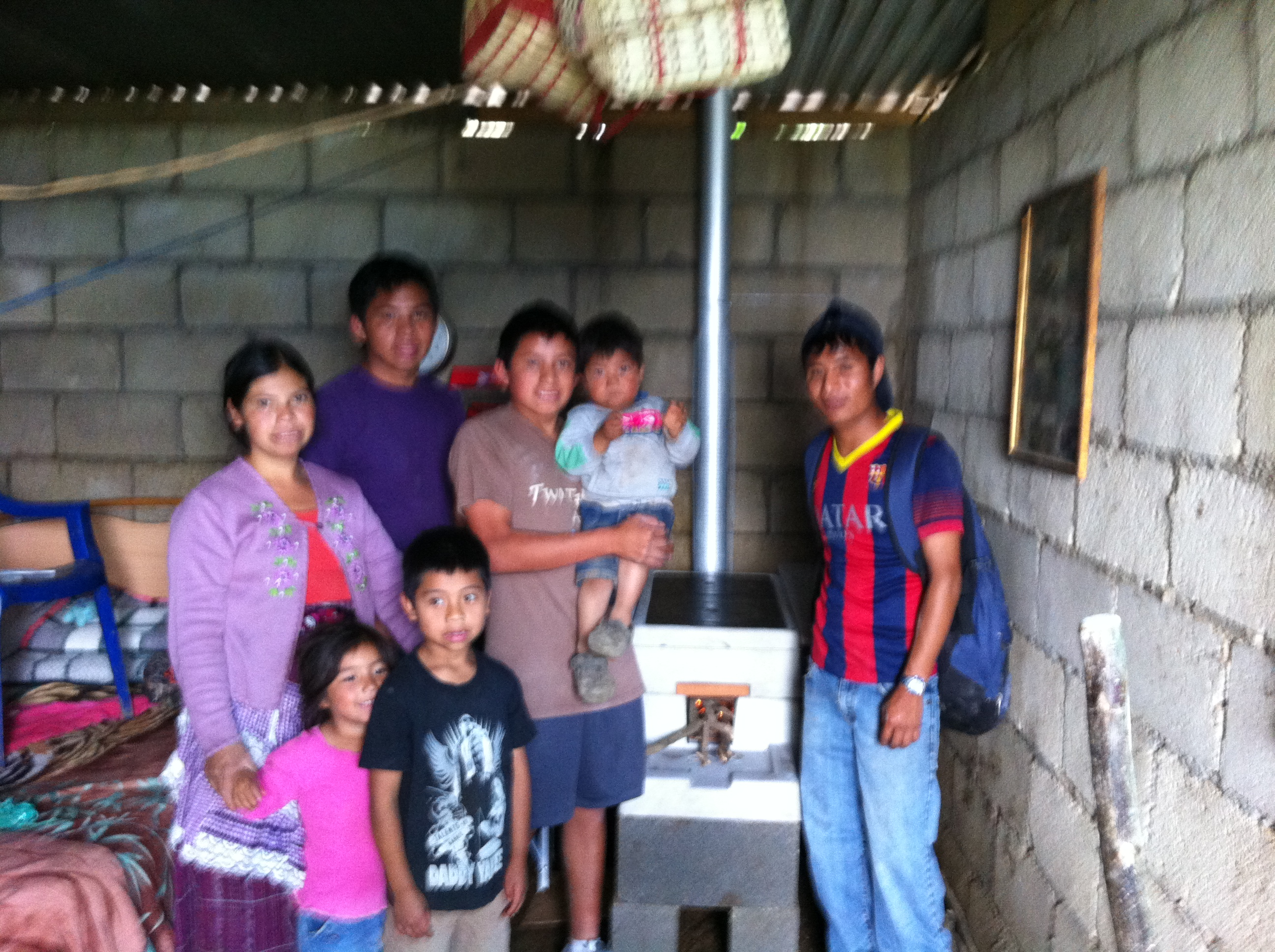 Marcos, Benjamin, & Hugo; brian after installing the stove for the lady who lost her baby