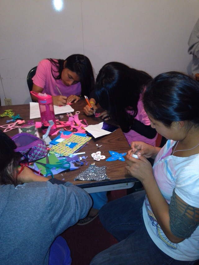 Girls making gifts for Ani's mother
