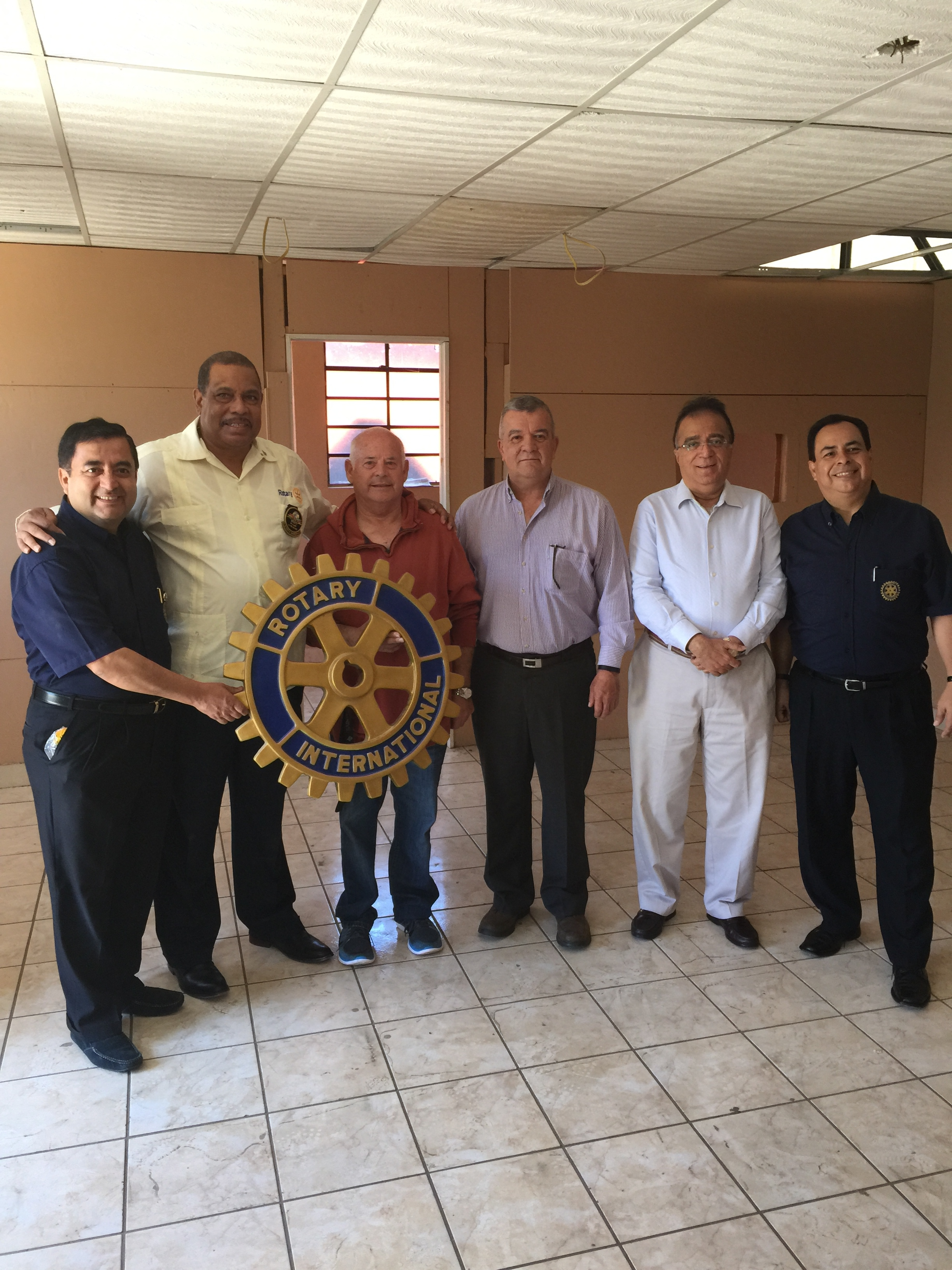 International Rotarians. The Governor is the large man