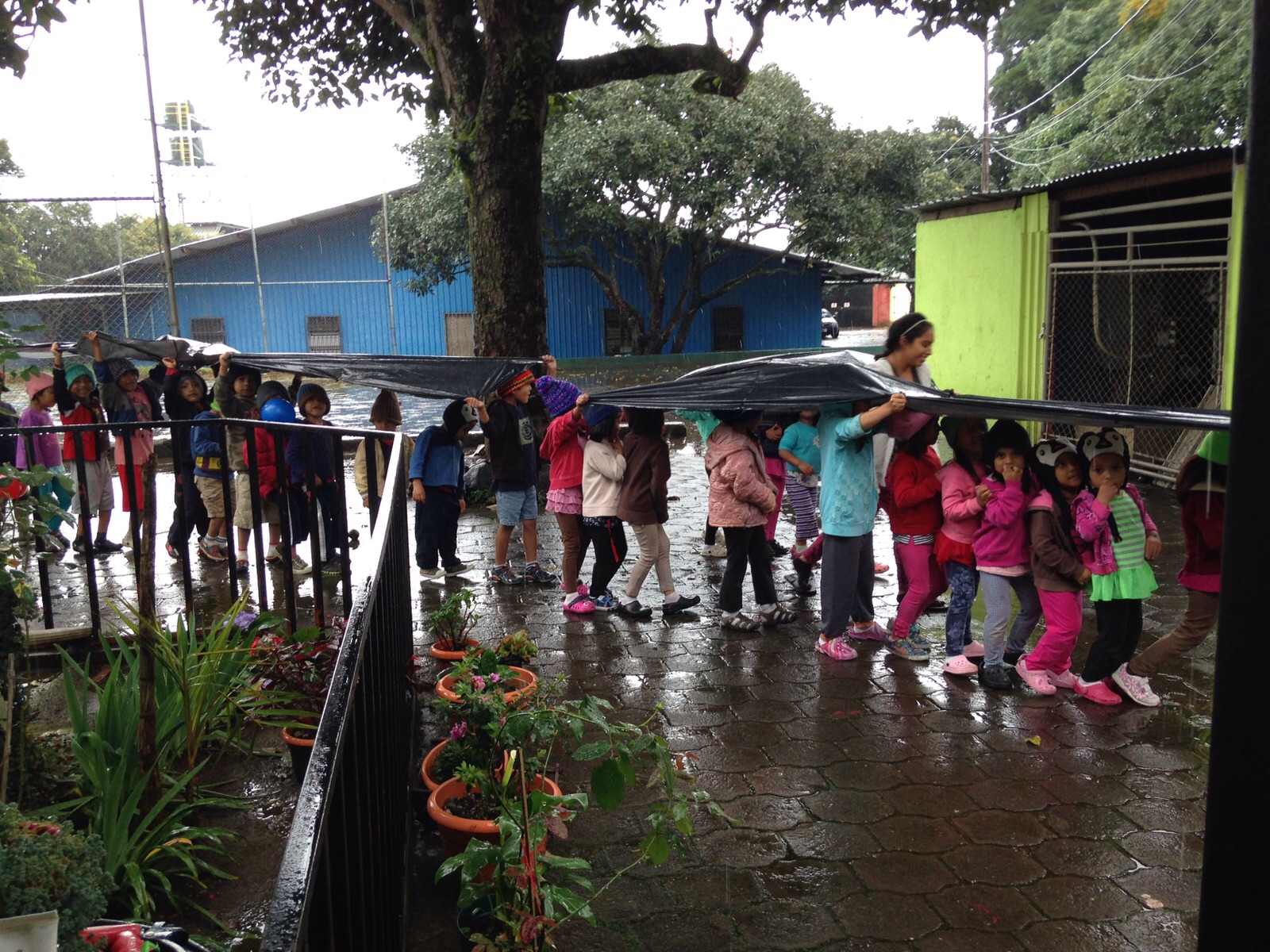 The rains have been unmerciful in Guatemala. These are our girls going to lunch