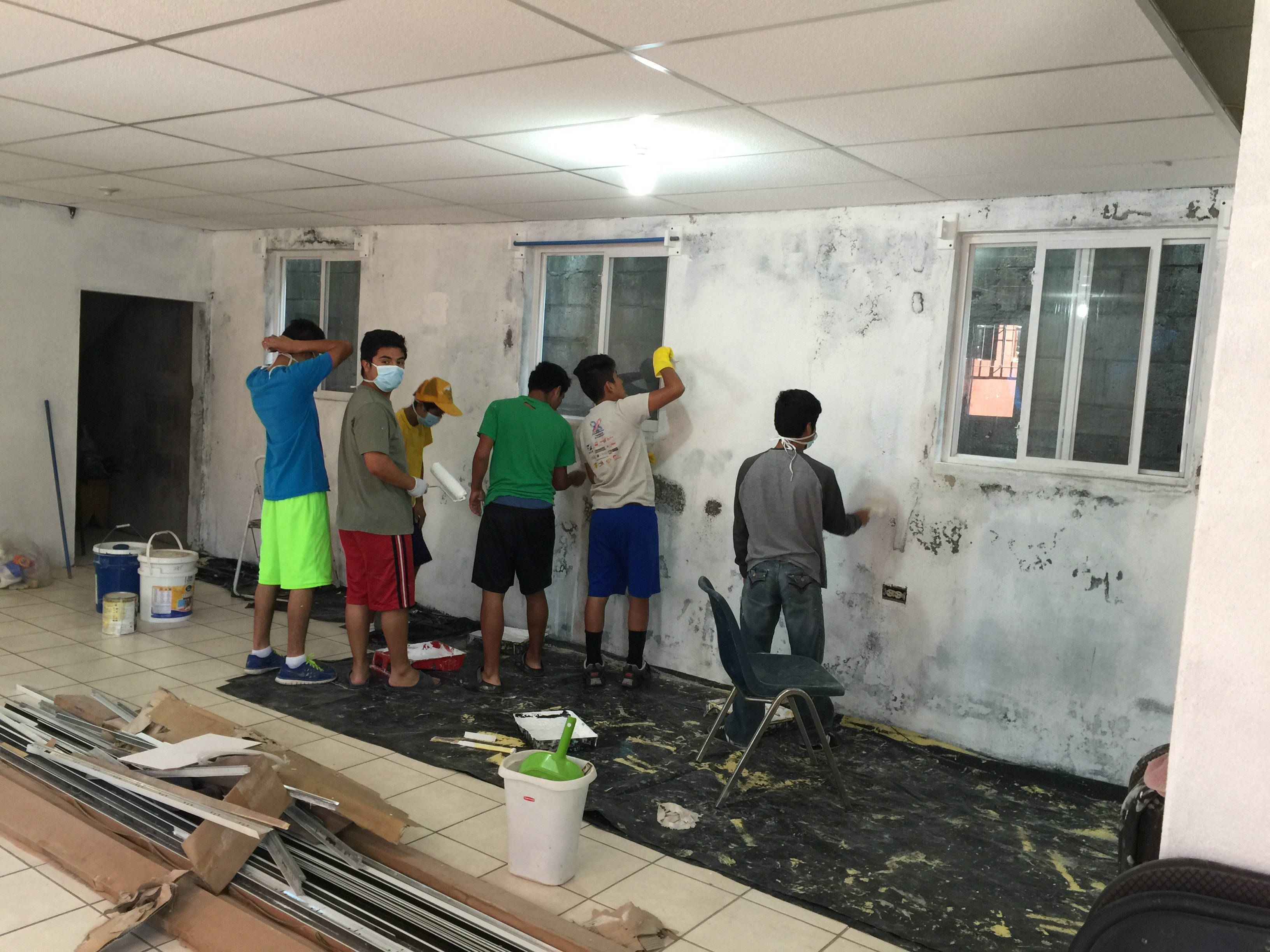 The boys who live in our home painting the visitor's dorm