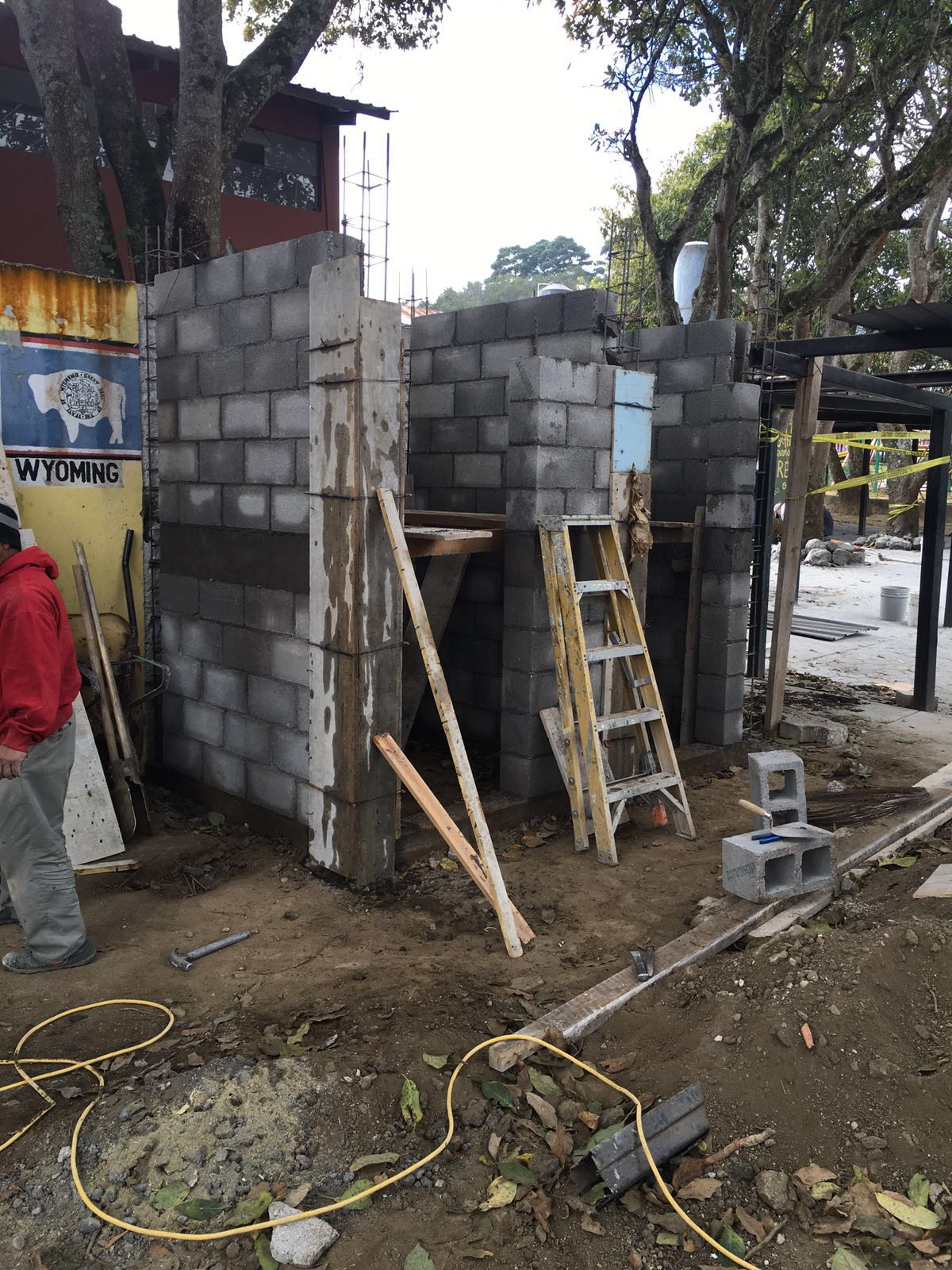 The outdoor sanitary facilities were moved when we tore down the dorm. These are the new ones and are readyfor the roof.