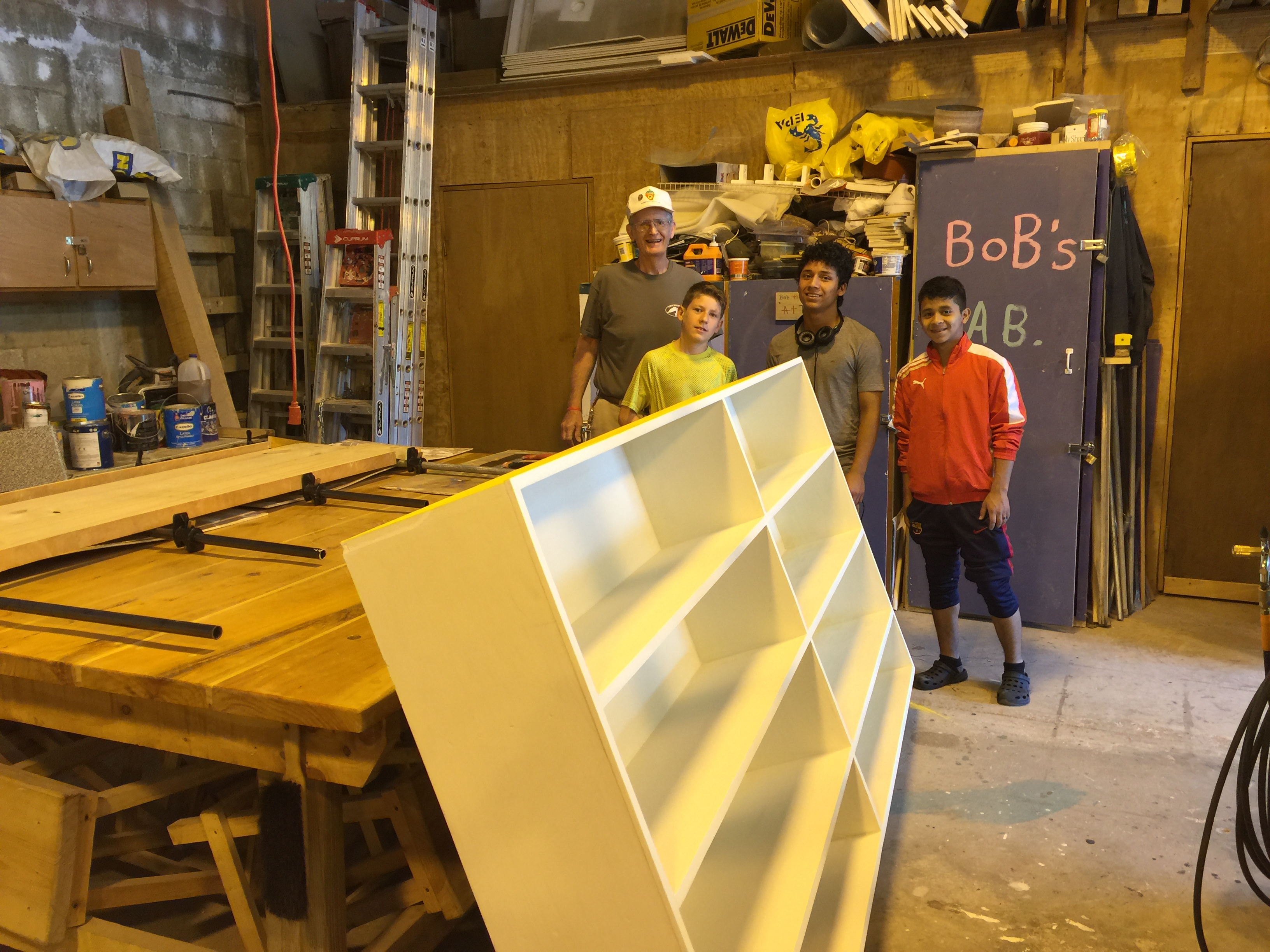 Bob's carpentry class has been making shelving for the school.