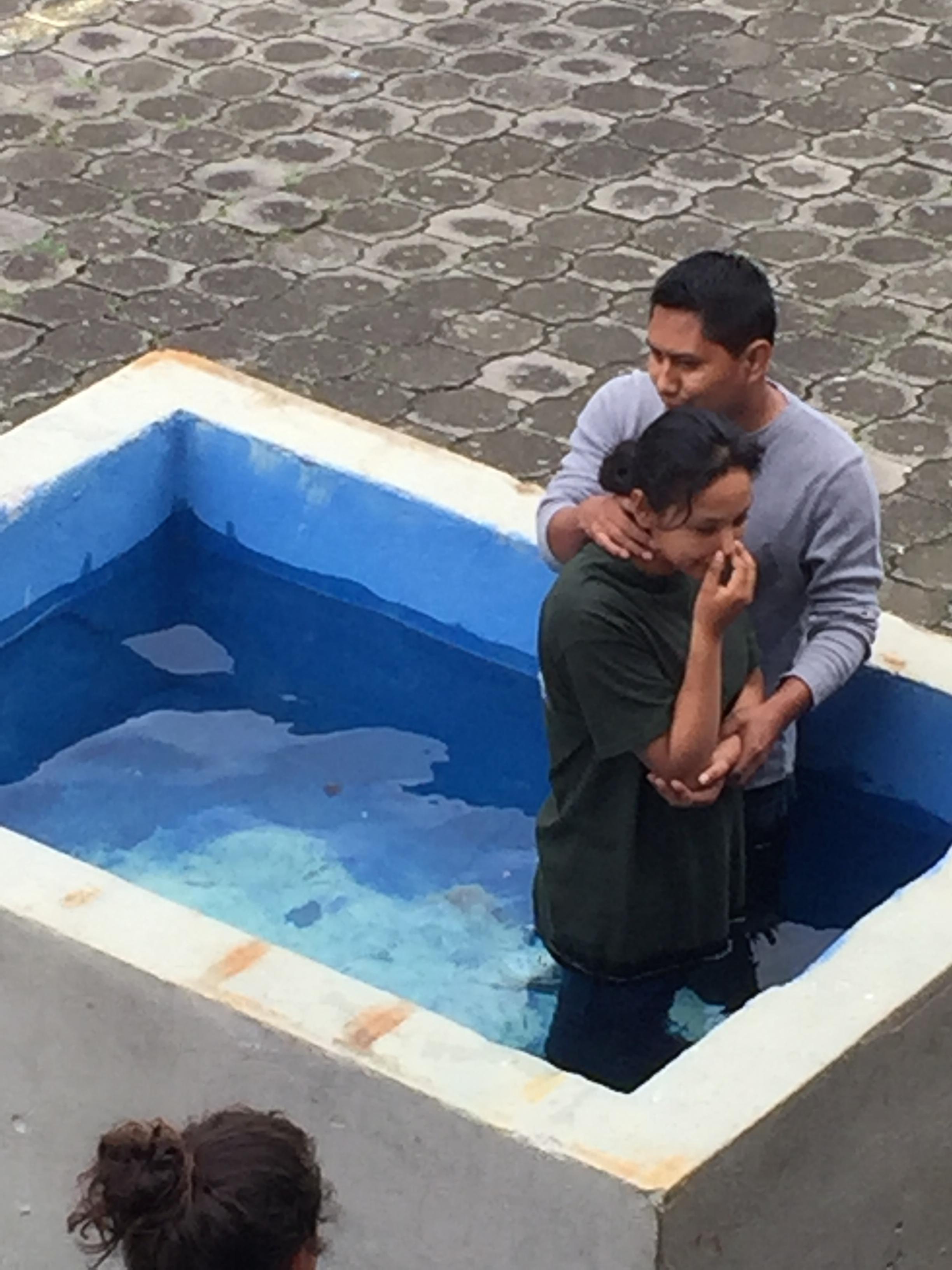 Ezdraz administering baptism