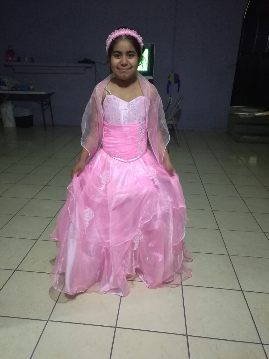 Cindy, dialysis, in her quinceanera's dress