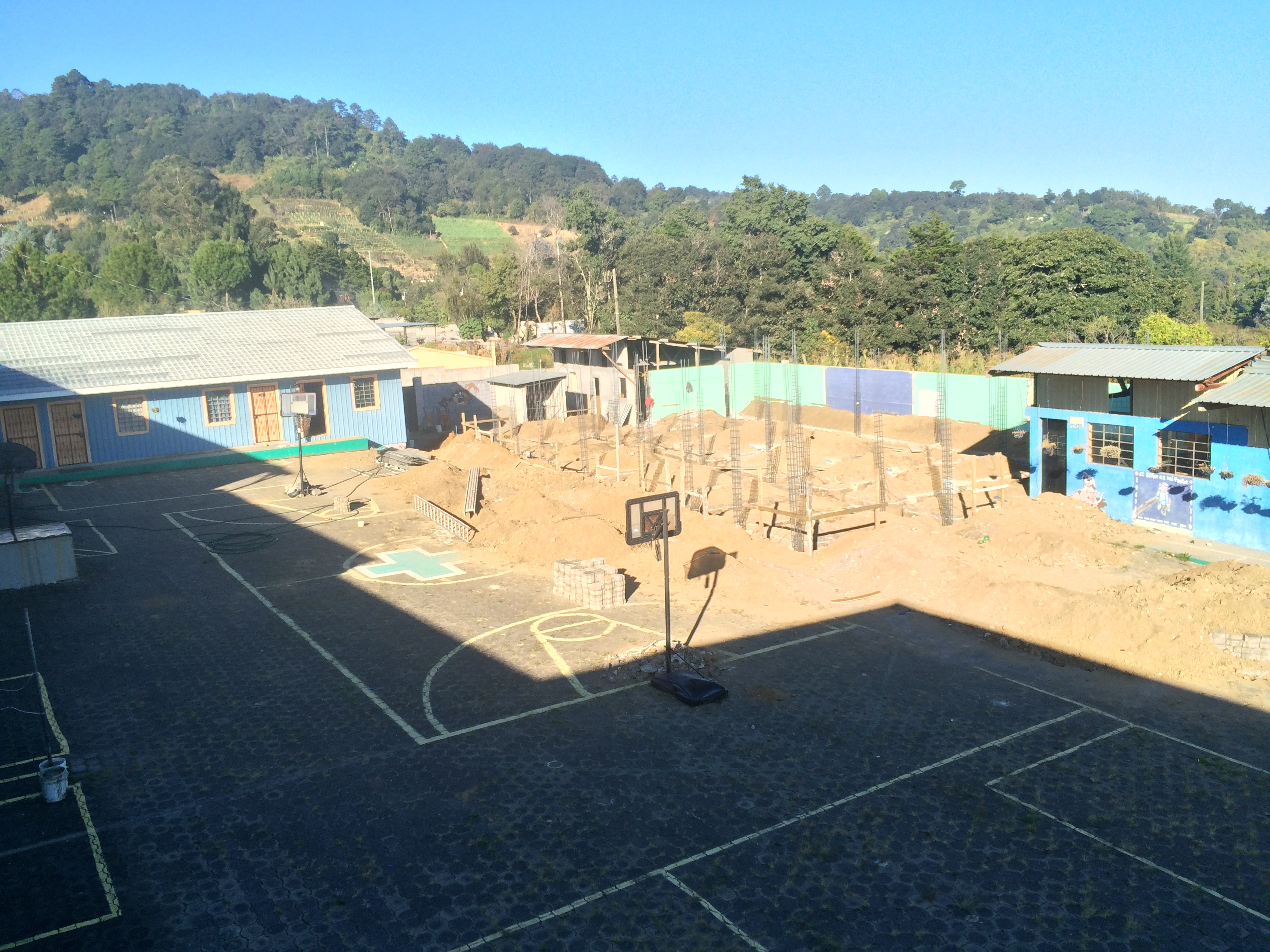 The site of the hospital between the school classes on the right and the school office on the left
